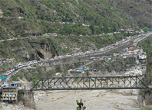 Stranded vehicles stand in queues after heavy rains in the Himalayan state of Uttarakhand. Photograph: Reuters