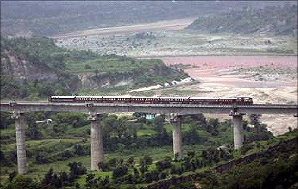 A passenger train coming from Udhampur moves over a bridge in Bazalata on the outskirts of Jammu.