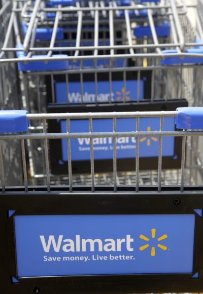 Shopping carts are seen outside a new Walmart Express store.