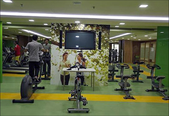 Employees work out at a gym inside Tech Mahindra office building in Noida on the outskirts of New Delhi.