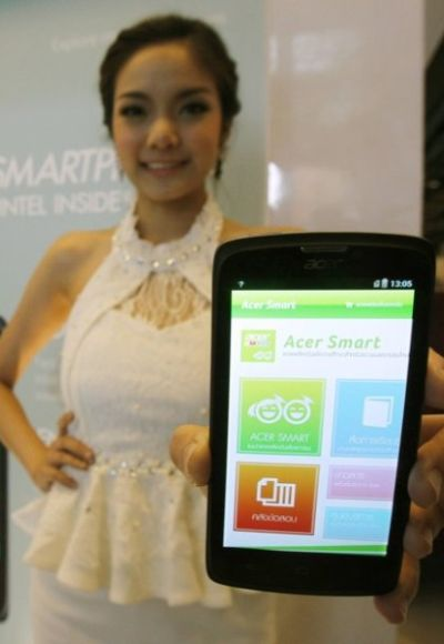 A model poses with an Acer Liquid C1 smartphone.