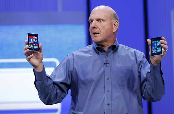 Steve Ballmer displays Windows phones during his keynote address at the Microsoft 'Build' conference in San Francisco, California.