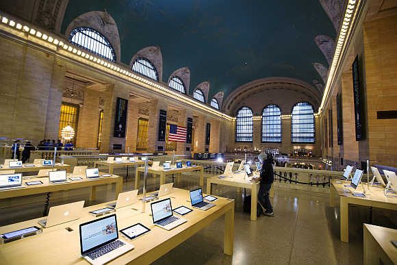 A man uses a computer at an Apple store inside the Grand Central Station in New York City.