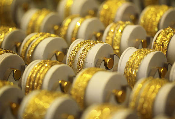 Gold prices take a dive but where are the buyers Rediffcom Business
