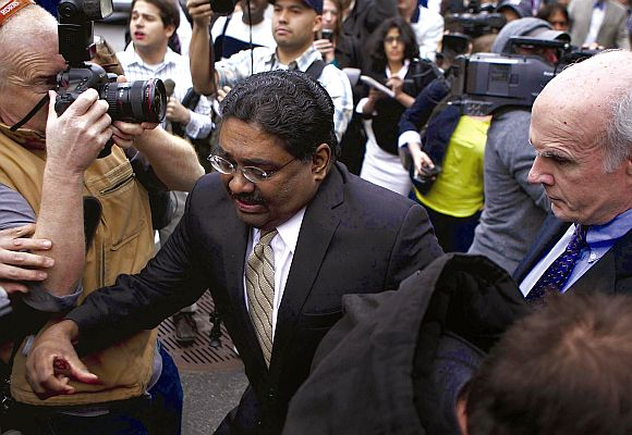 Galleon hedge fund founder Raj Rajaratnam was swarmed in as he left Manhattan Federal Court, where he was found guilty of 14 counts of insider trading.