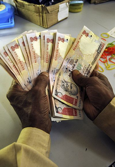 Rupee falls by 9 paise to 60.22 in volatile trade