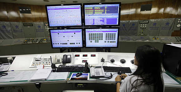 A technician works in the control room inside Furnas hydroelectric dam in Sao Jose da Barra, Central Brazil.