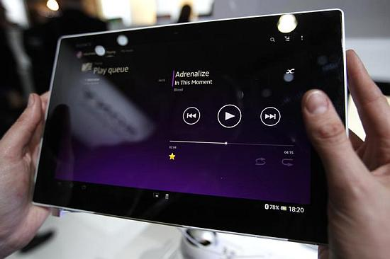 A visitor holds the new Sony Xperia Z Tablet.