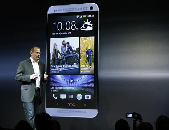 HTC president Jason Mackenzie shows the new HTC One.
