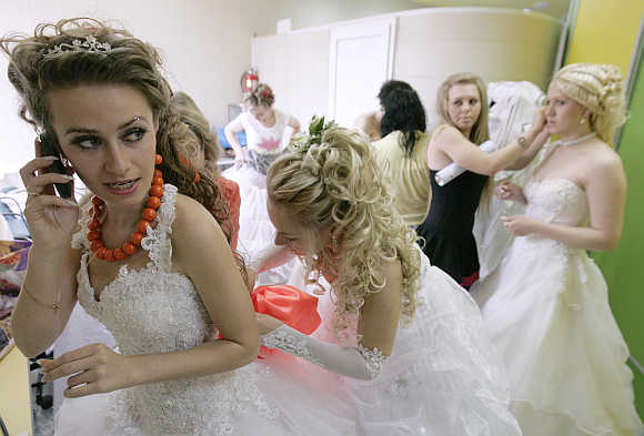 Women in bridal gowns take part in a carnival for newly wed brides in Russia's southern city of Stavropol.