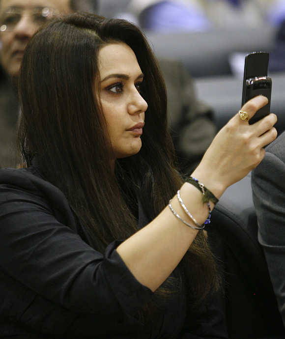 Actress Preity Zinta takes pictures with her mobile phone in Gandhinagar, Gujarat.
