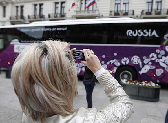 A fan takes a picture with a mobile phone at the Bristol Hotel in Warsaw.
