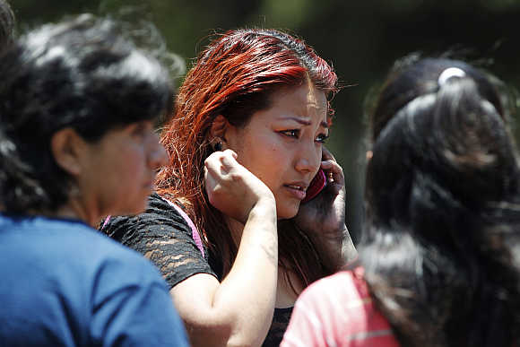 A woman reacts as she talks on her mobile phone in the business district of Santa Fe, Mexico City.