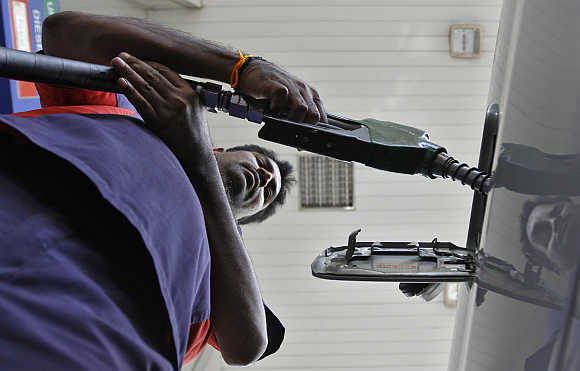 A worker fills diesel at a fuel station in Chennai.