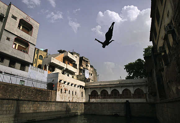 A boy jumps into a well inside the shrine of Sufi Saint Nizamuddin Auliya in New Delhi. Above, Nandan Nilekani.