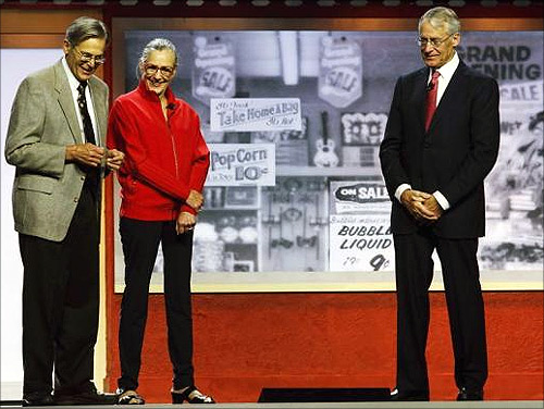 Jim Walton (L), Alice Walton, and Rob Walton speak during the annual Wal-Mart shareholders' meeting in Fayetteville, Arkansas.