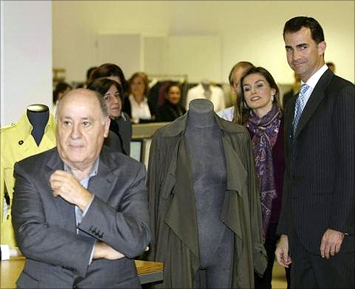 Spain's Princess Letizia and Crown Prince Felipe (R) stand next to chairman of Spanish global fashion group Inditex, Amancio Ortega (L), during a visit to an Inditex factory in Coruna, northern Spain.