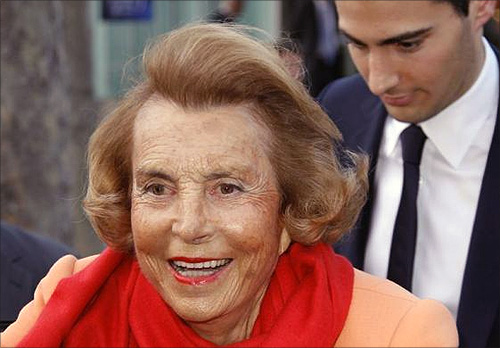 Liliane Bettencourt (L), heiress to the L'Oreal fortune leaves with Jean-Victor Meyers, her grandson, the L'Oreal-UNESCO prize for women in Paris.