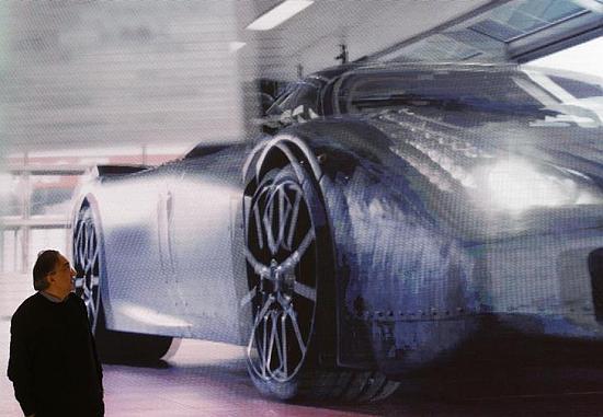Fiat CEO Sergio Marchionne looks at a presentation of the new LaFerrari hybrid car.