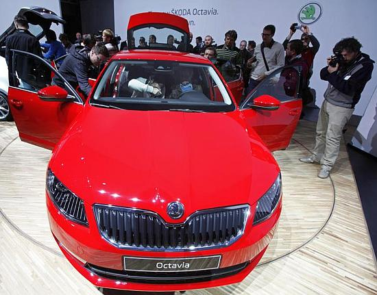Visitors observe a new Skoda Octavia.