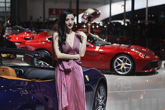 A model stands next to a Ferrari California in Beijing, China.