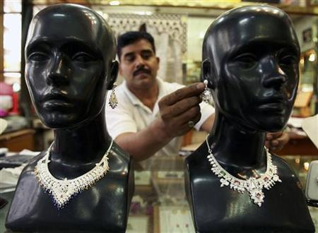A shopkeeper displays silver jewellery at a shop in Jammu.