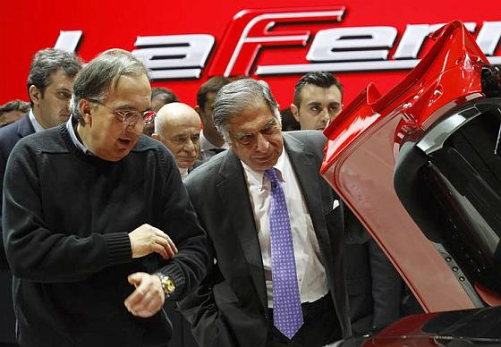 Ratan Tata and Fiat CEO Sergio Marchionne (L) inspect the new LaFerrari hybrid car.