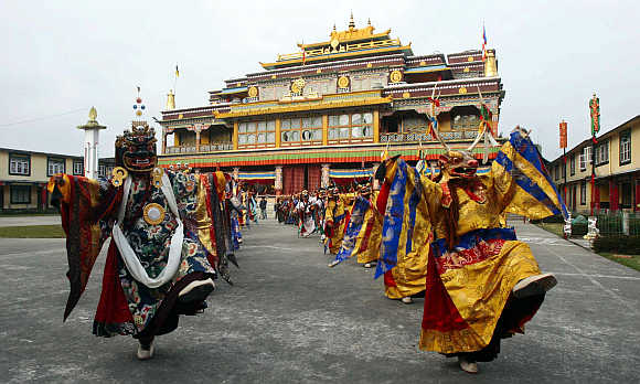 Buddhist monks perform chaam (masked) dance at Ralong village, about 76km south from Gangtok, Sikkim.