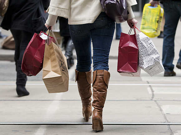 A woman carries shopping bags during the Christmas shopping season in Toronto.