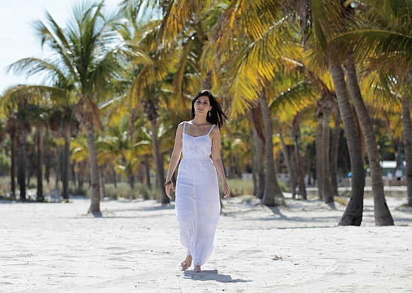 Cuban immigrant Ana Soto poses on Virginia Key in Miami, Florida.
