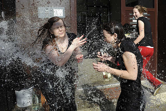 Girls are hit by water from a bucket thrown by Slovak youths as part of Easter celebrations in Trencianska Tepla, 145km north of Bratislava, Slovakia.