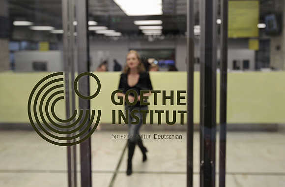A woman walks inside the Goethe-Institut in Athens, Greece.