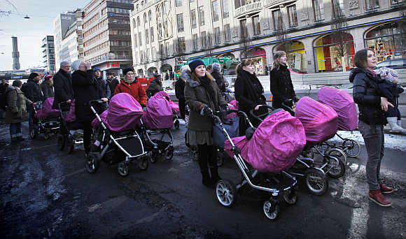 People march through downtown Stockholm as part of a campaign to stop maternal mortality on International Women's Day, Sweden.