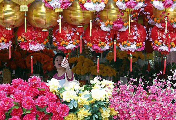 An ethnic Chinese Malaysian woman shops for decorations ahead of the Chinese Lunar New Year in Kuala Lumpur.