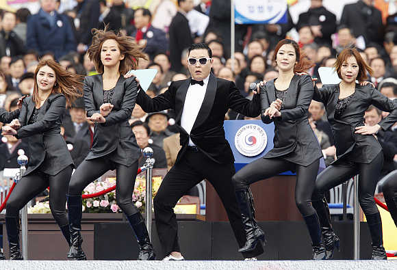 Singer Psy centre, performs at the parliament in Seoul.