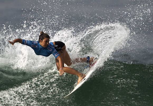 Coco Ho of Hawaii surfs at Barra da Tijuca beach in Rio de Janeiro.