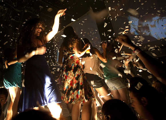 Spring breakers dance during a party at a bar in Cancun, Mexico.