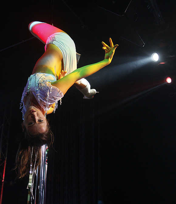 A woman performs a pole dancing routine during a competition in Singapore.