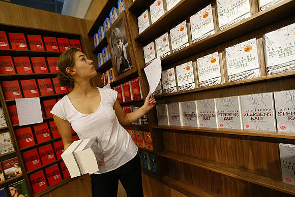 A woman sorts books at a book fair in Frankfurt, Germany.