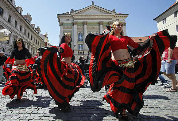Participants of the Khamoro World Roma Festival dance through the historical centre of Prague, the Czech Republic.