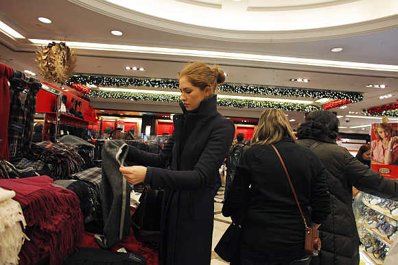 A woman shops at the scarf section inside Macy's Manhattan department store in New York City.