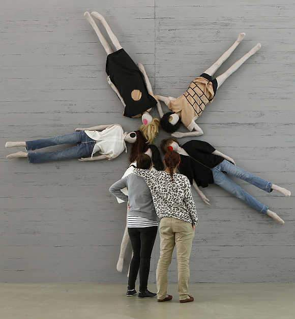 Visitors stand in front of the installation 'A Uniform Sample' at the Aargauer Kunsthaus art museum in the town of Aarau, west of Zurich, Switzerland.