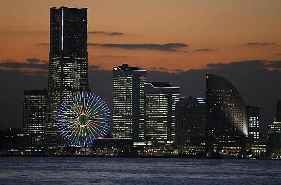 The sun sets in Yokohama, south of Tokyo.