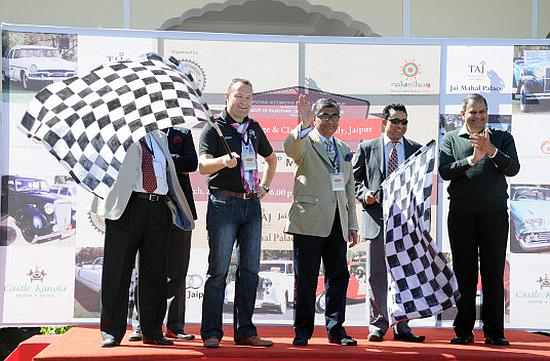 Brand director and head of Audi India Michael Perschke, on the left, flagging off the rally.