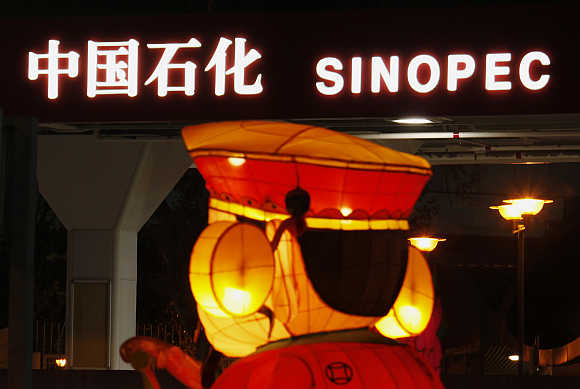 A Chinese New Year lantern installation is displayed outside a Sinopec gas station in Hong Kong.
