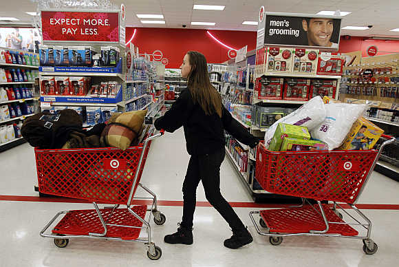A woman pulls shopping carts through the aisle in Torrington, Connecticut, United States.