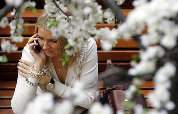 A woman speaks on the phone at a department store in Moscow.