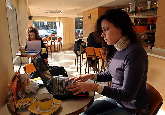 Women work on their computers at a cafe in Cairo, Egypt.