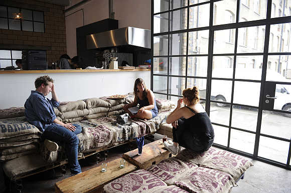 Customers at the White Building, a restaurant and studio space in Hackney Wick, London, United Kingdom.