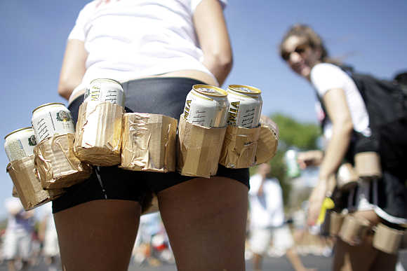 A girl carries a belt of beers during the Race of Beer in Brasilia, Brazil.